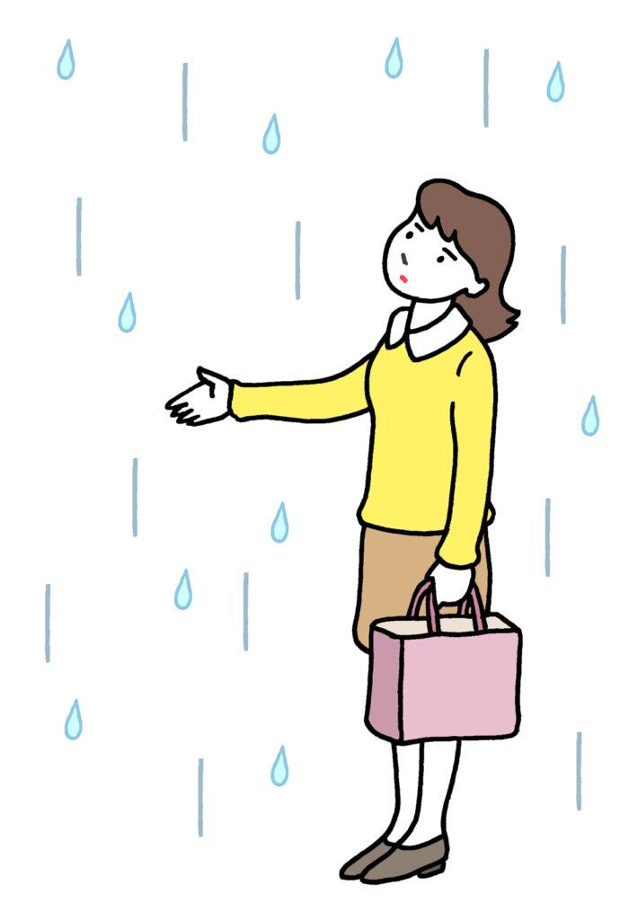 突然の雨に困る女性